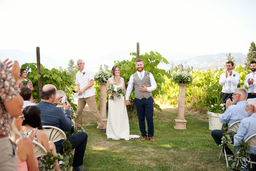newlyweds after vineyard wedding ceremony in Kelowna captured by Tara Whittaker Photography