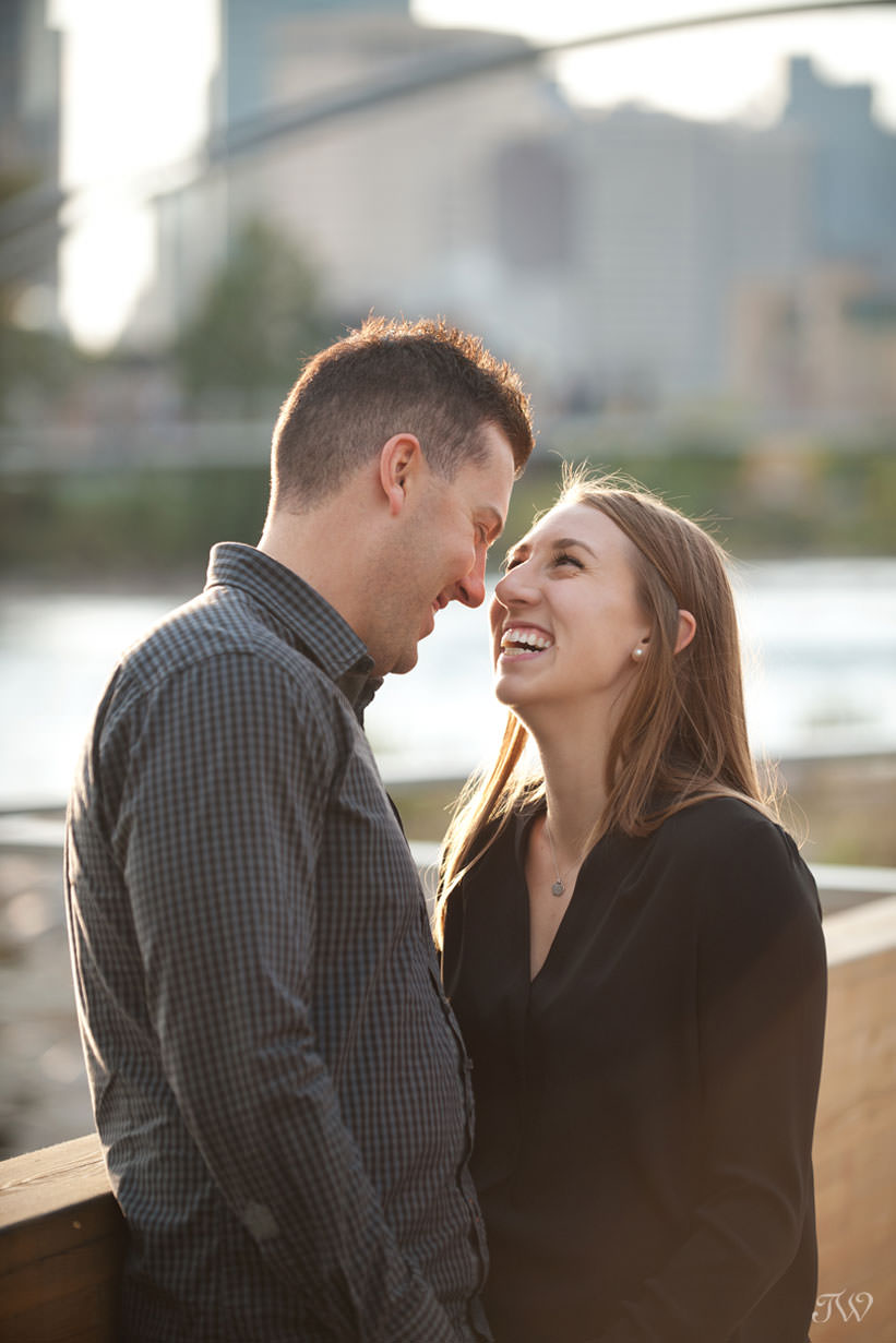 Sharing a laugh during East Village engagement session captured by Tara Whittaker Photography