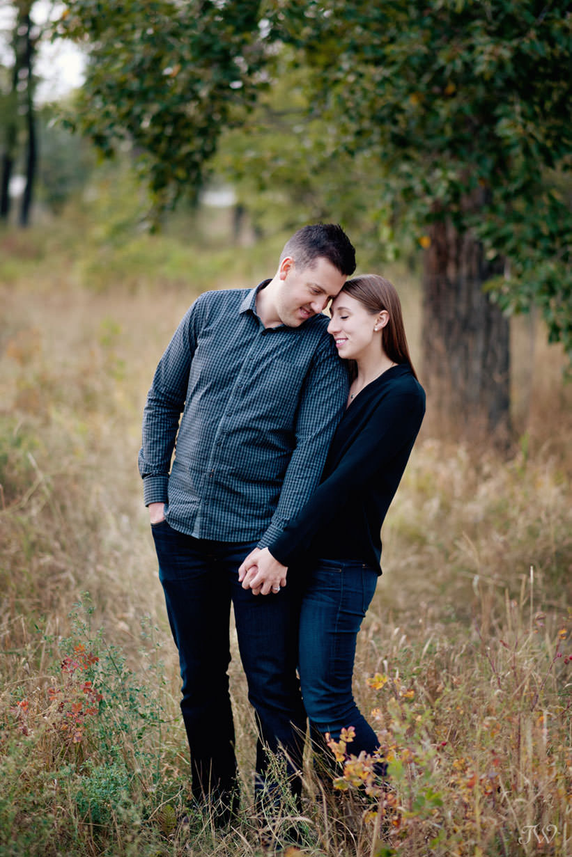Sweet moment during East Village engagement session captured by Tara Whittaker Photography