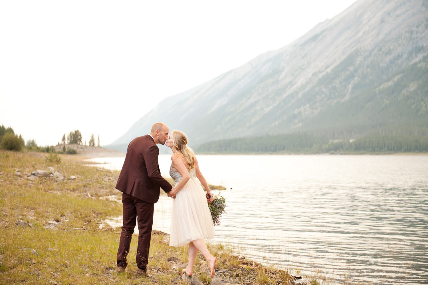 couple on the shore of Spray Lakes captured by Tara Whittaker Photography