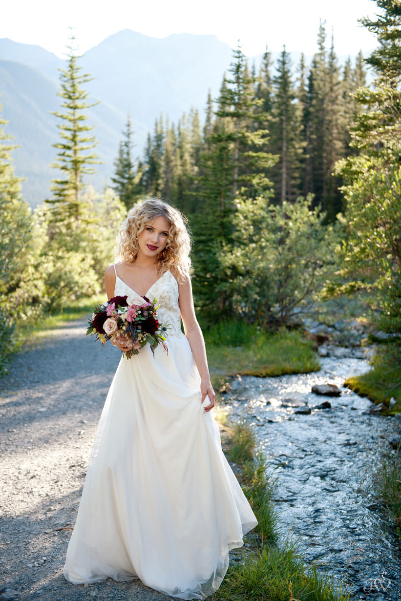 Bride during Canmore wedding photos at Goat Creek captured by Tara Whittaker Photography