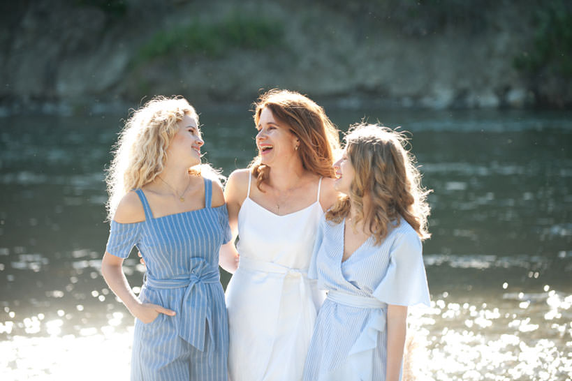Mika and her daughters pose for family photos at Sandy Beach captured by Tara Whittaker Photography