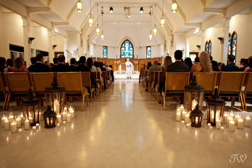 candles at St Stephen's Church captured by Calgary wedding photographer Tara Whittaker