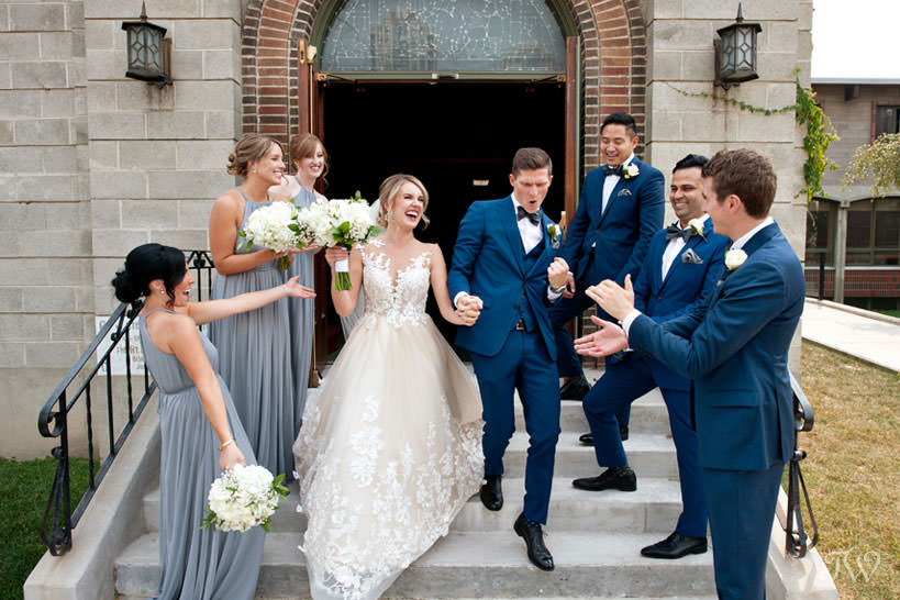 grand exit from St Stephen's Church captured by Calgary wedding photographer Tara Whittaker