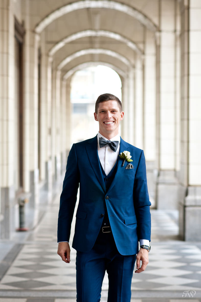 groom at Hudson Bay on Stephen Avenue captured by Calgary wedding photographer Tara Whittaker