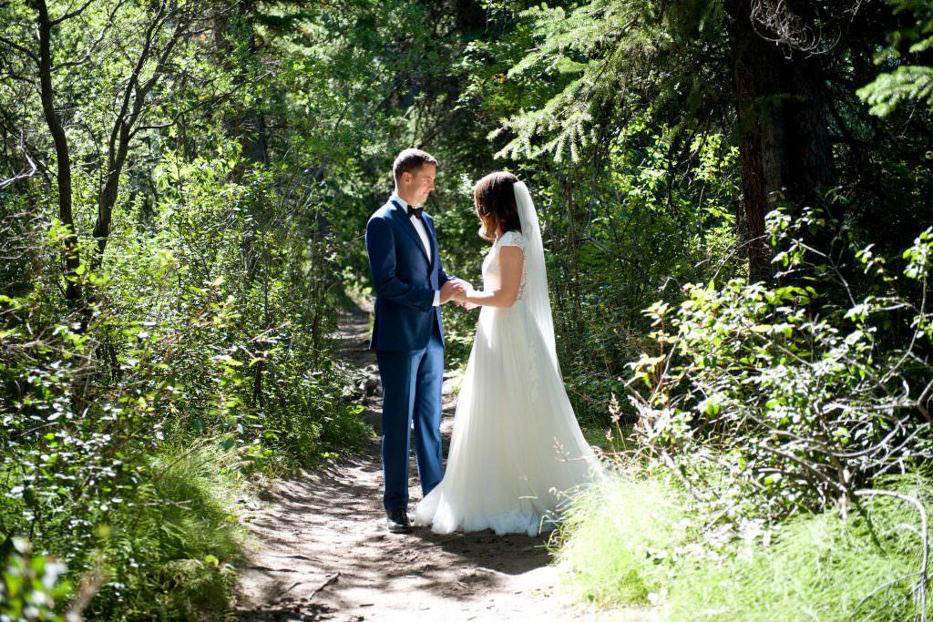 Bride and groom's first look before their Silvertip Resort Wedding