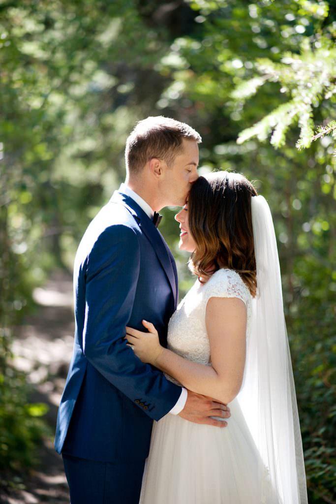 Bride and groom kiss before their Silvertip Resort Wedding