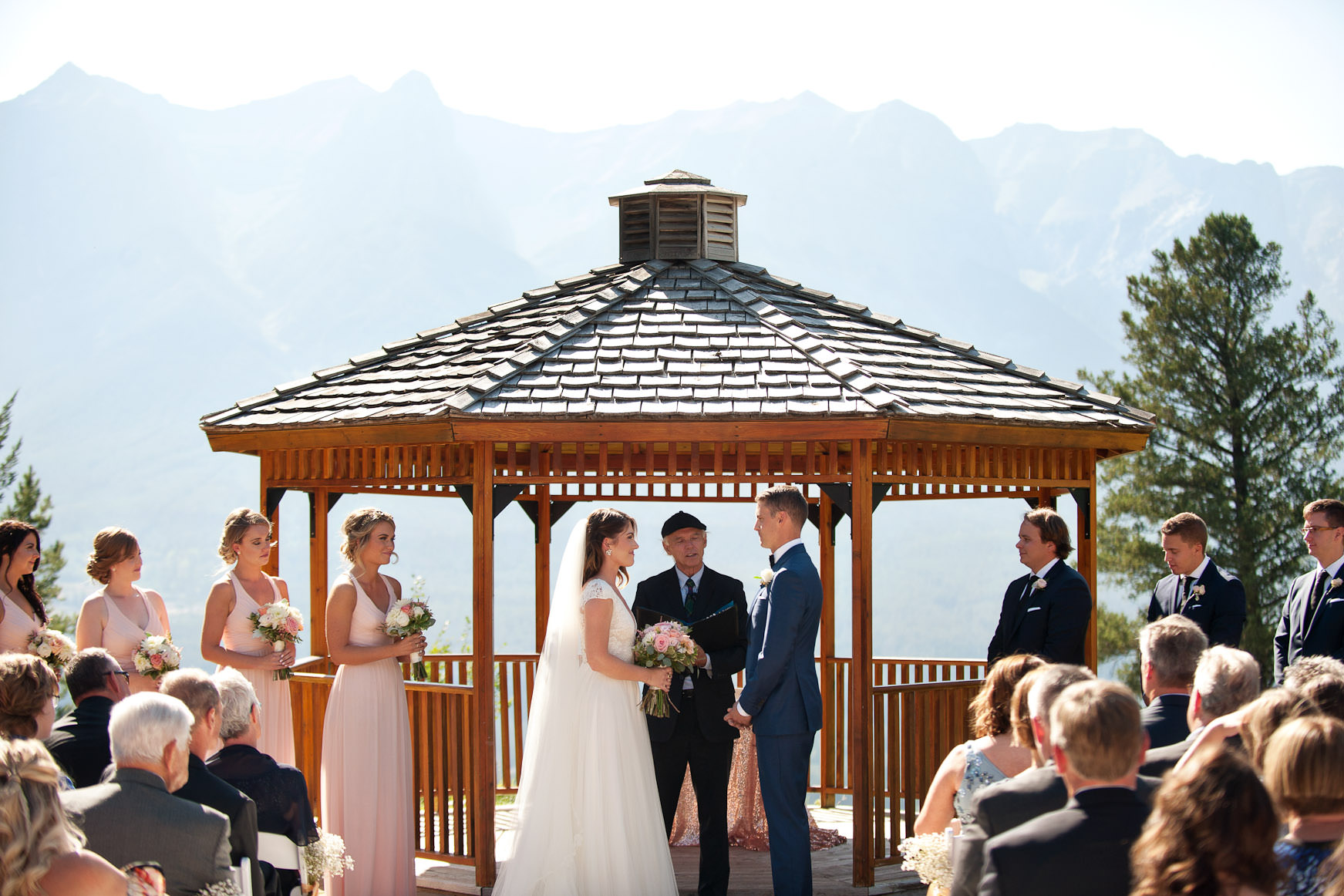 bride and groom exchanging vows at their Silvertip Resort wedding