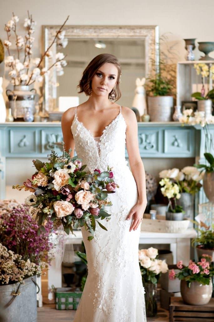 bride at Fleurish Flower Shop Tara Whittaker best wedding photographers in Alberta