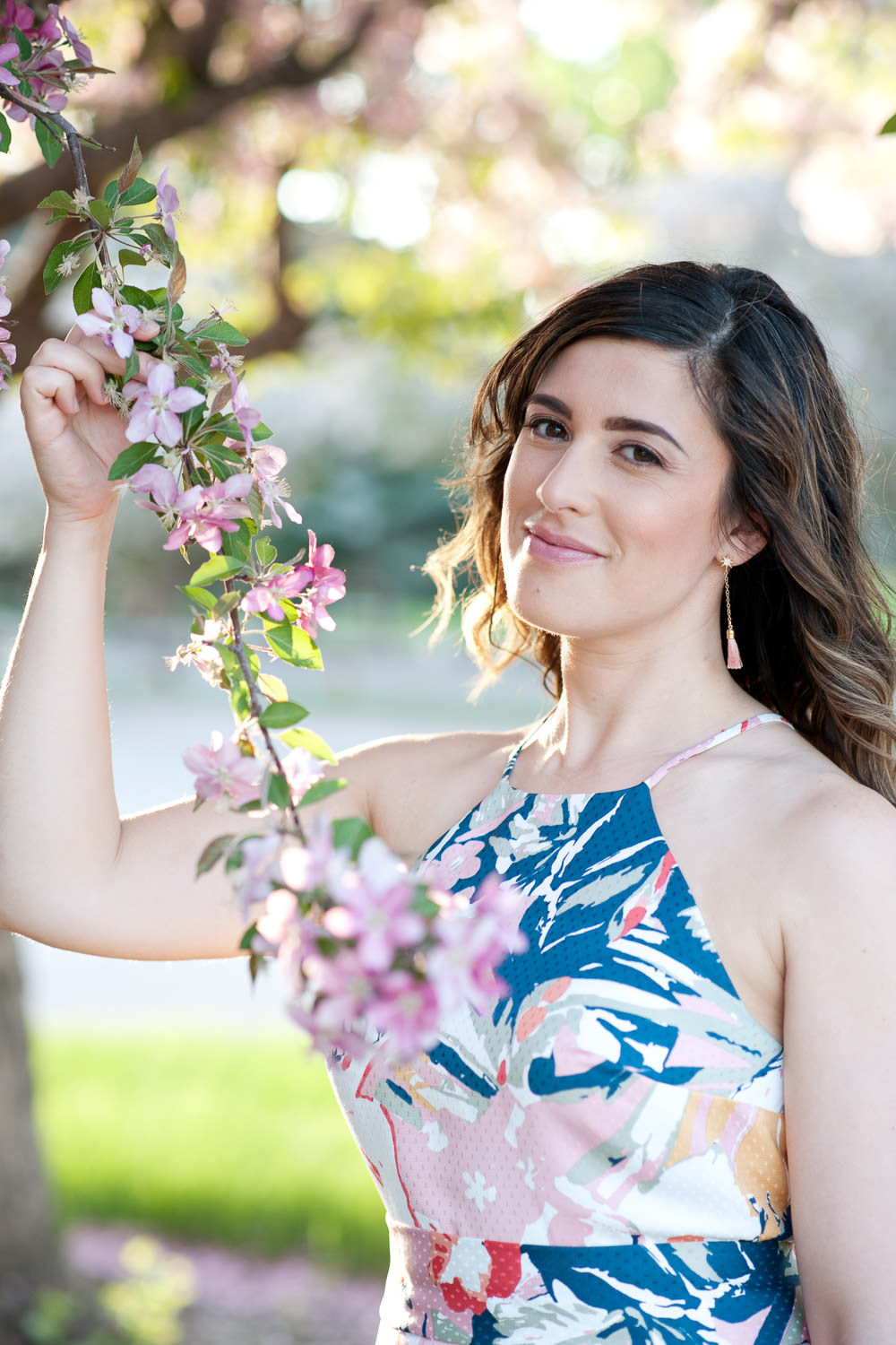 Janelle during cherry blossom season captured by Calgary lifestyle photographer Tara Whittaker