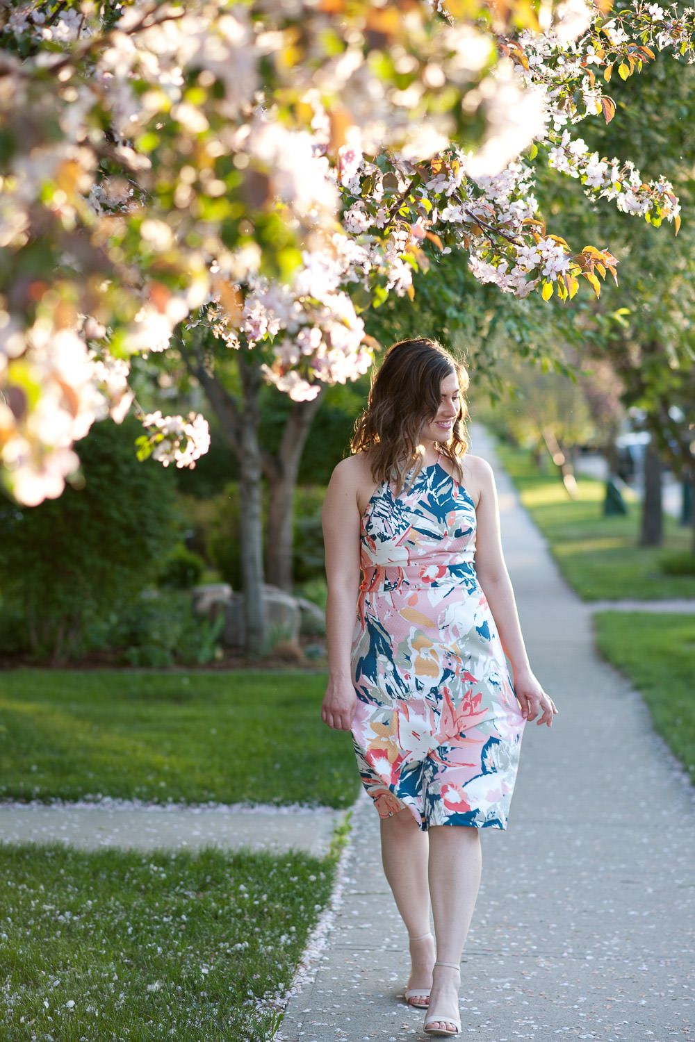 Janelle strolling in cherry blossoms captured by Calgary Lifestyle Photographer Tara Whittaker