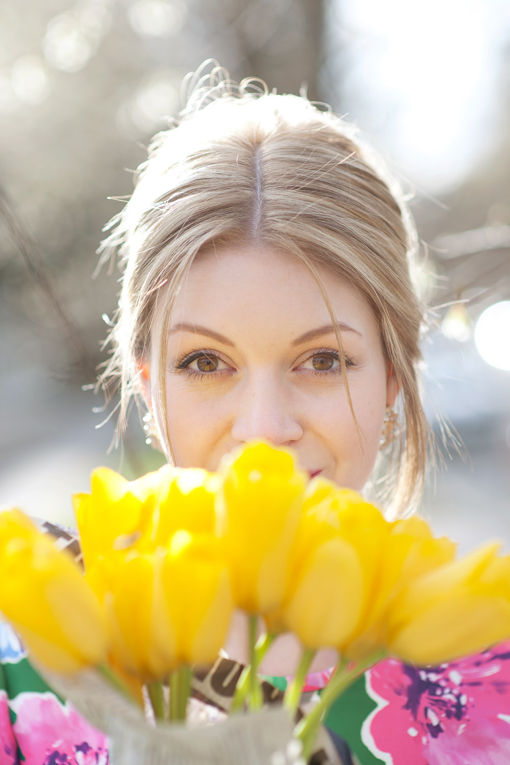 Ashley carrying tulips captured by Calgary Lifestyle Photographer Tara Whittaker