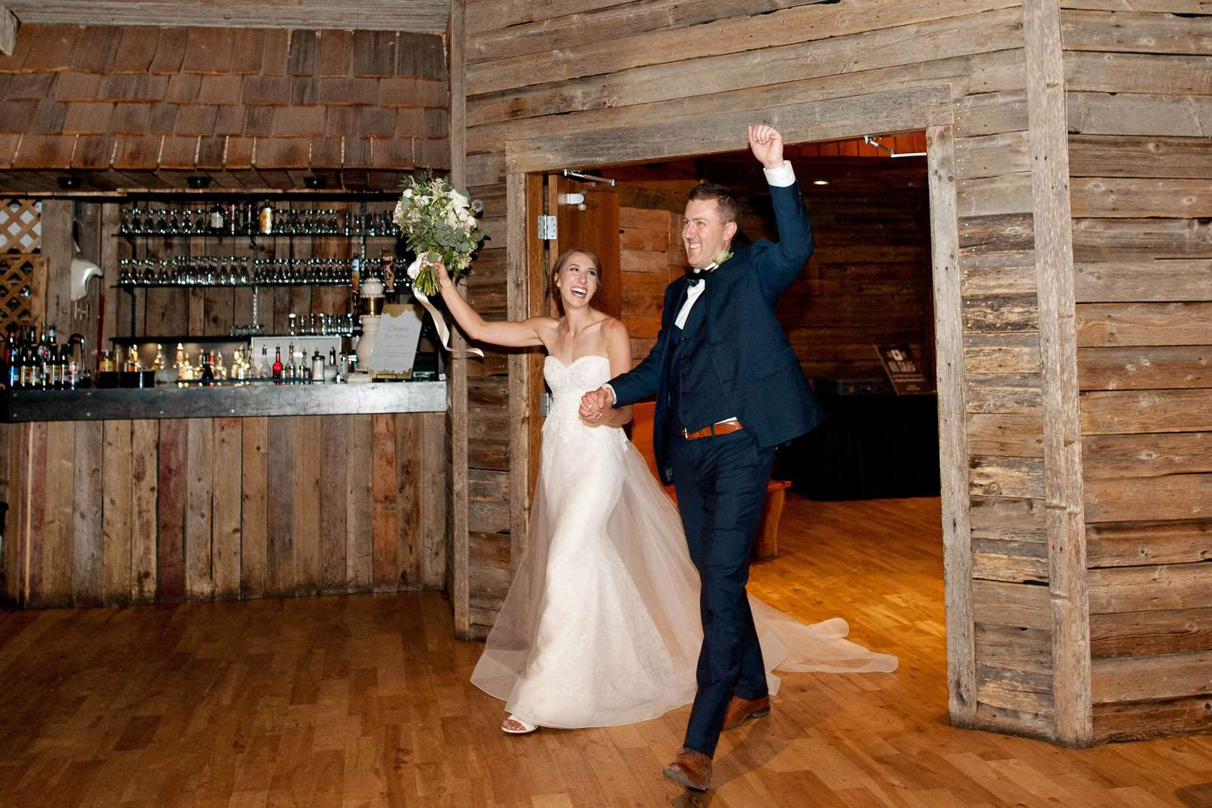 Bride and groom make their grand entrance at Cornerstone in Canmore