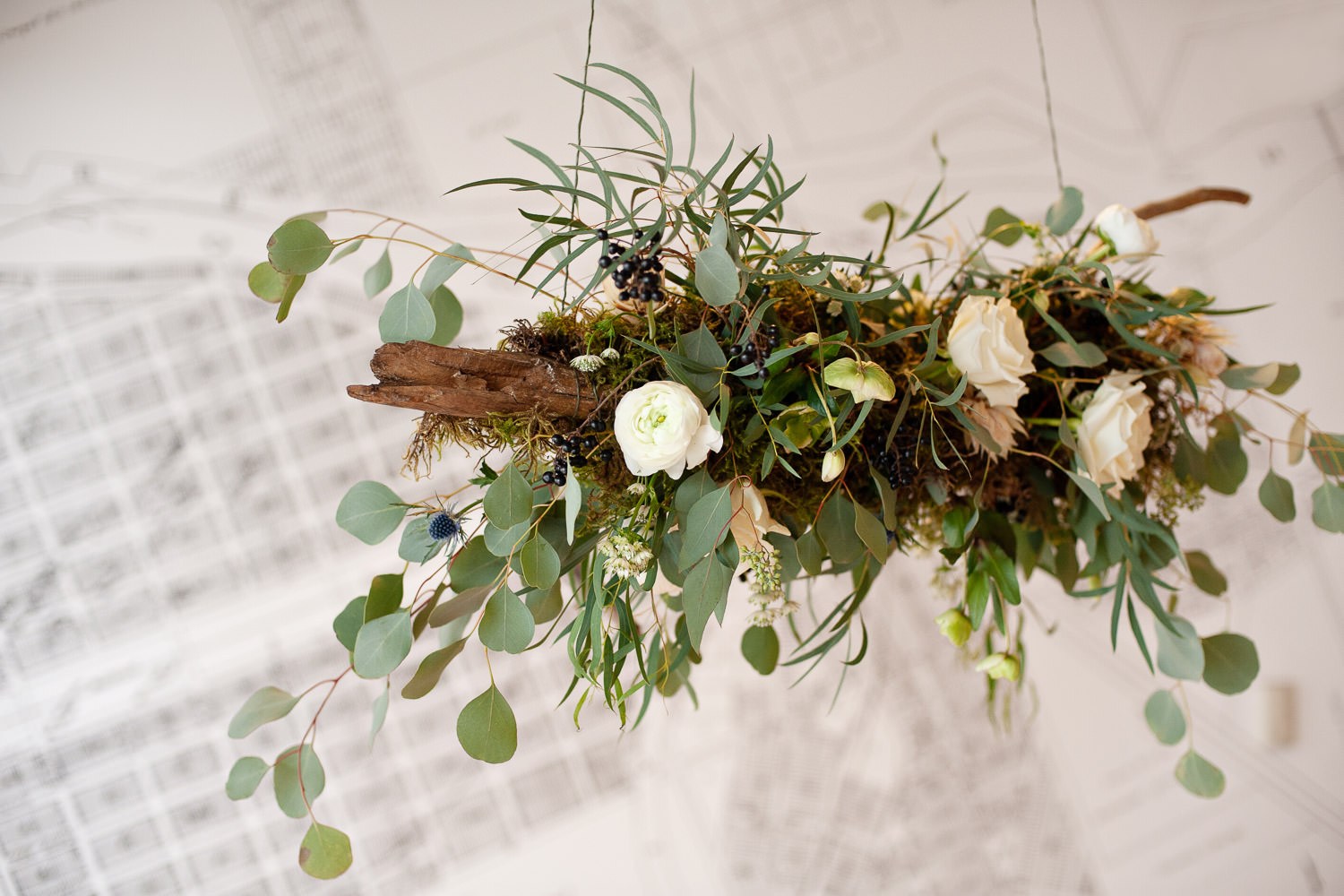 Hanging floral driftwood inspiration from Sweet Blooms captured by Calgary wedding photographer Tara Whittaker