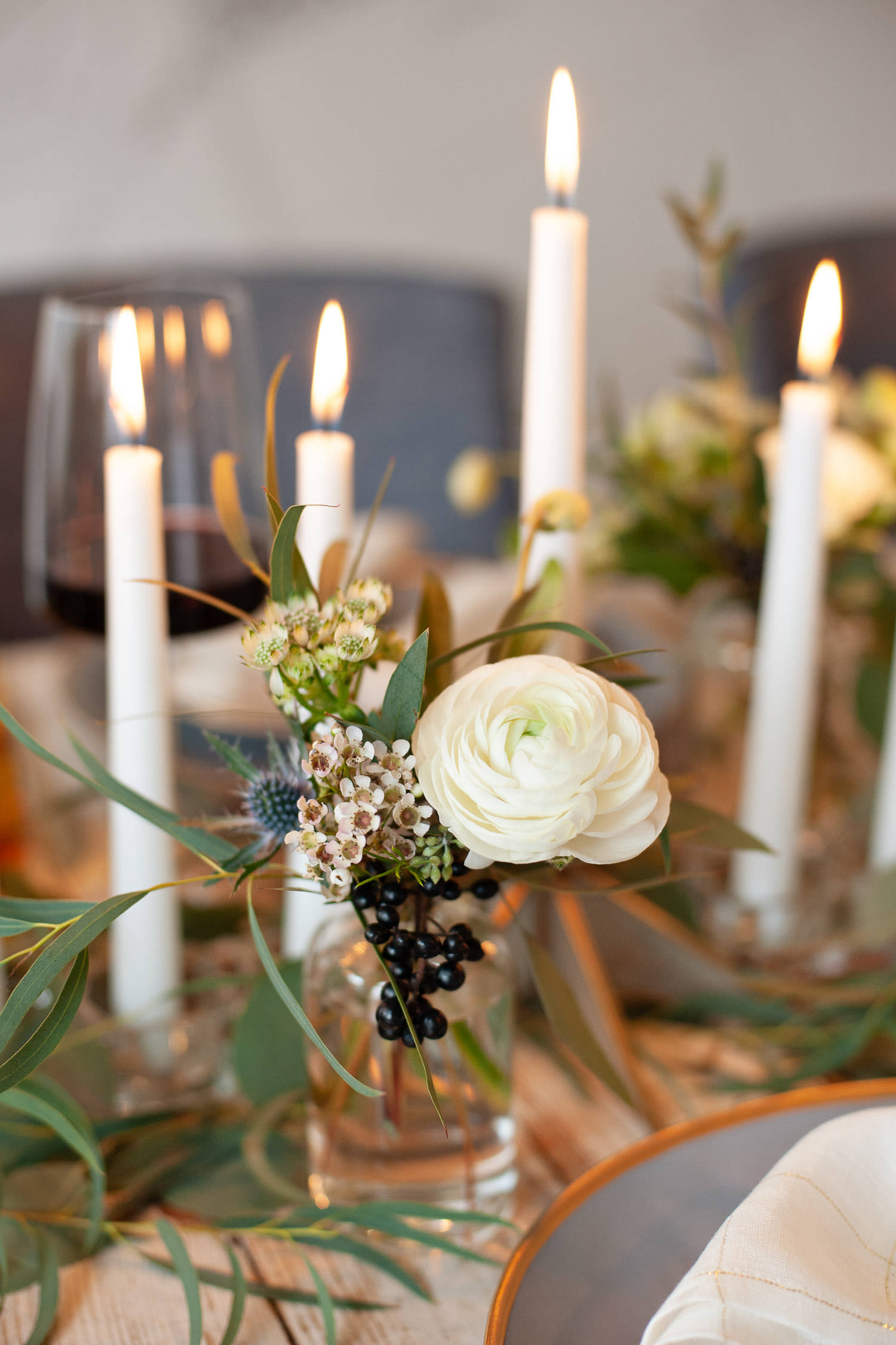 flickering candles on Hanukkah table captured by Calgary wedding photographer Tara Whittaker