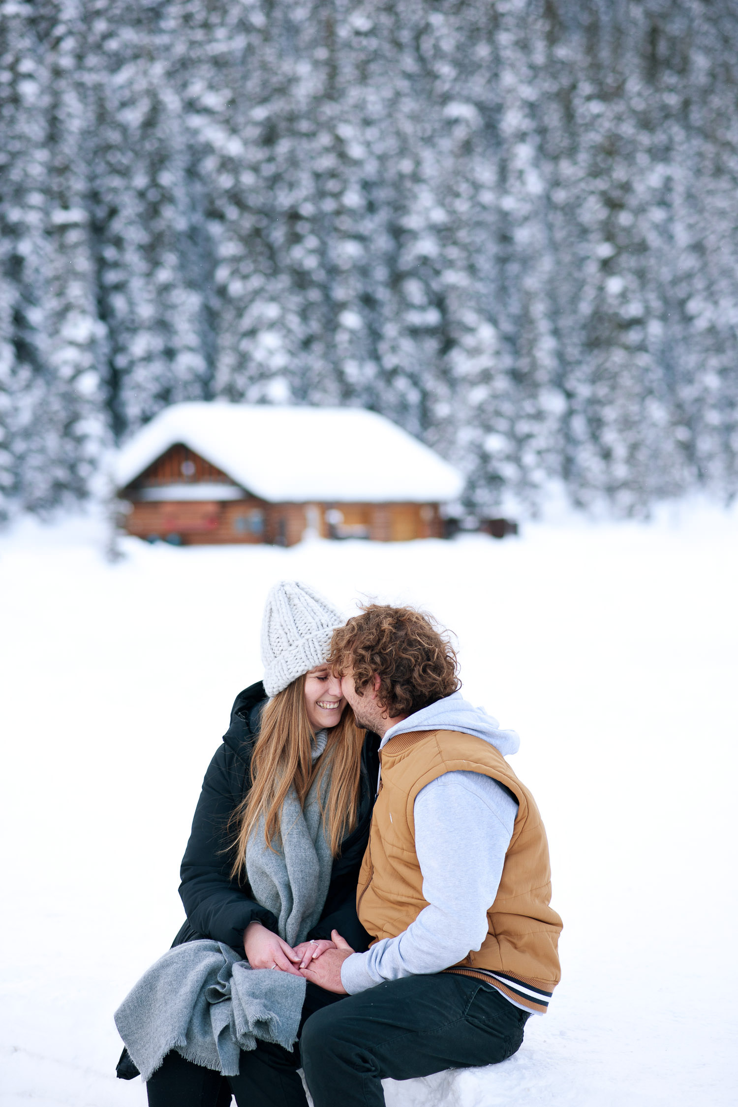 winter engagement at Lake Louise captured by Tara Whittaker Photography