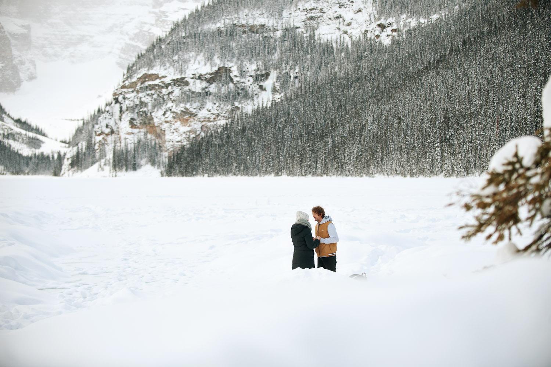 Surprise proposal at Lake Louise captured by Calgary wedding photographer Tara Whittaker