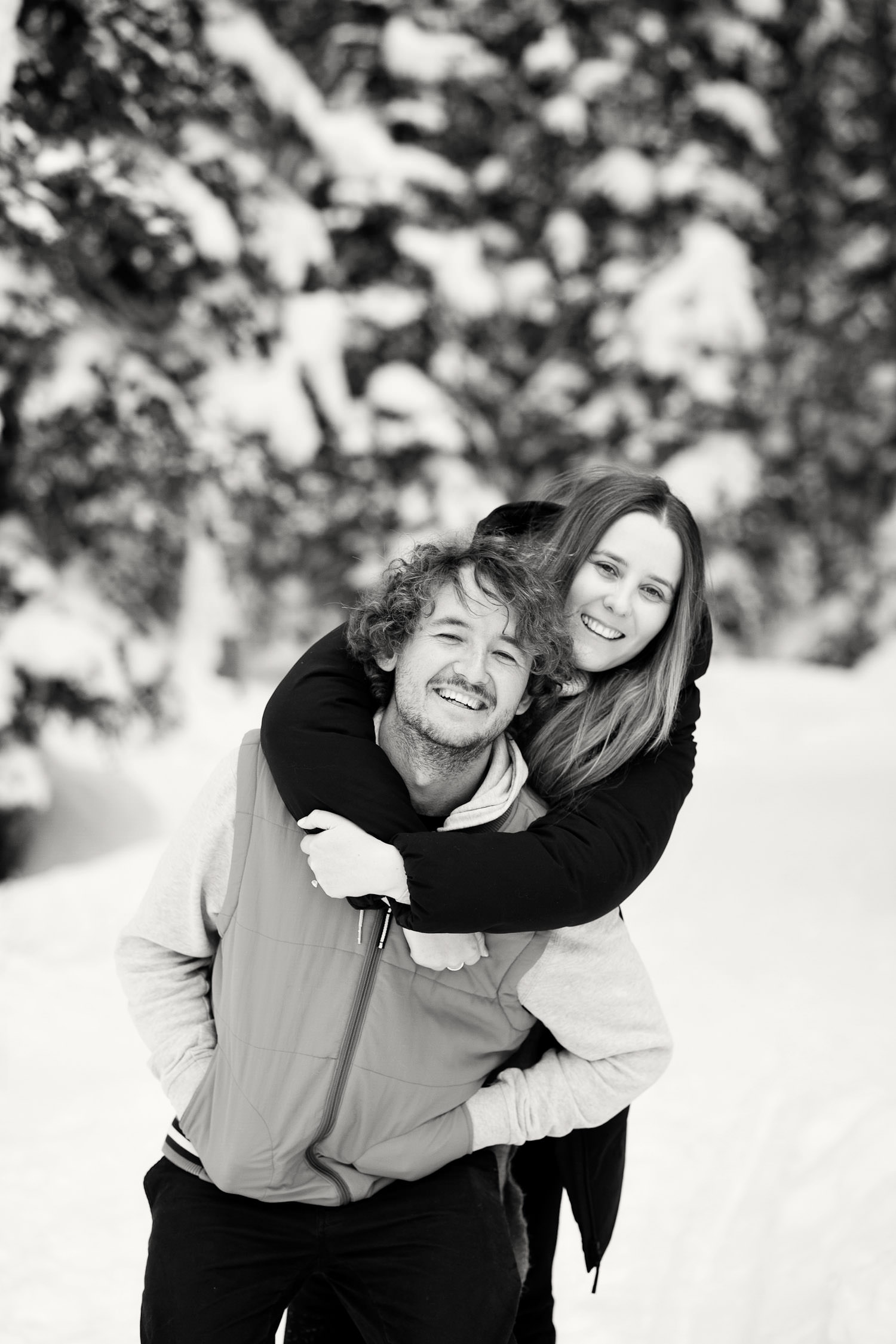 happy couple during engagement session at Lake Louise captured by Tara Whittaker Photography