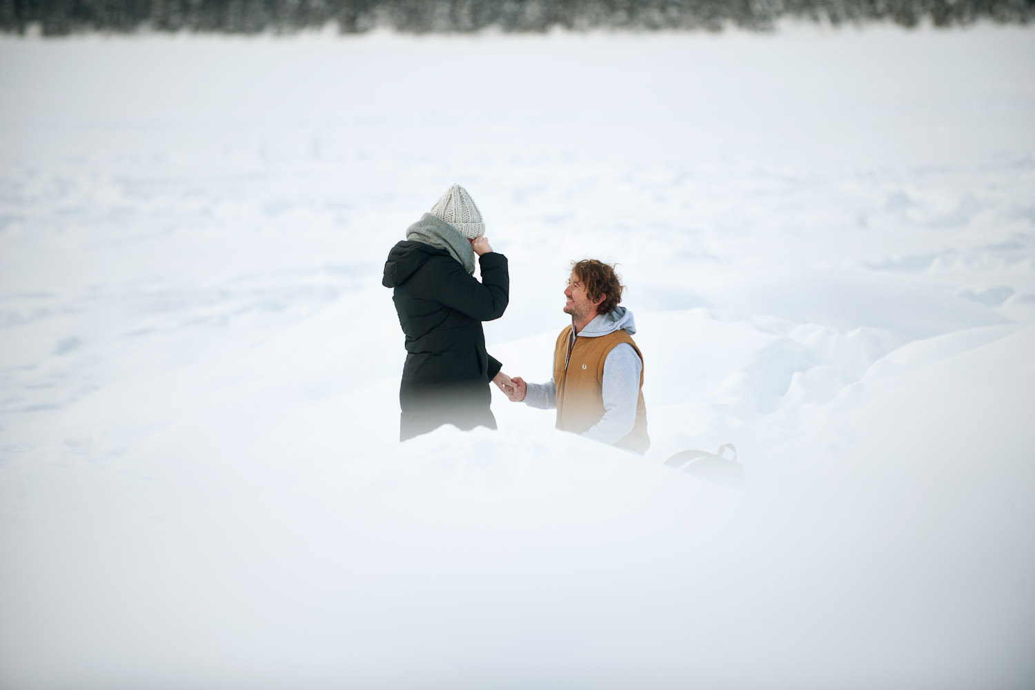 Brendan dropped to one knee to propose to Katherine at Lake Louise captured by Calgary wedding photographer Tara Whittaker