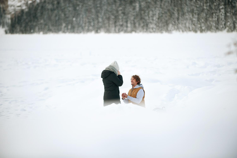 Lake Louise proposal captured by Calgary wedding photographer Tara Whittaker