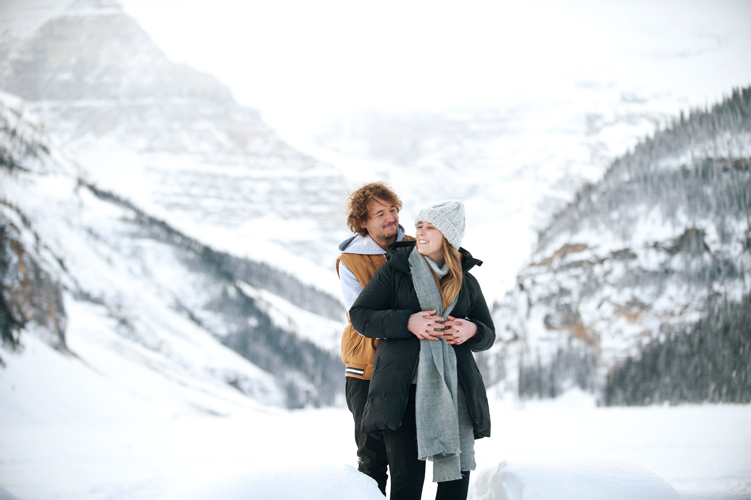winter engagement session at Lake Louise captured by Calgary wedding photographer Tara Whittaker