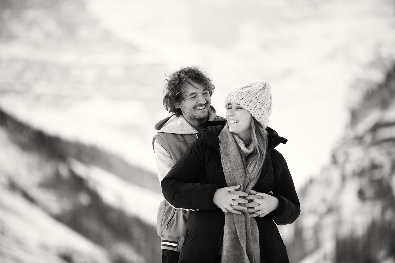 newly engaged couple at Lake Louise captured by Calgary wedding photographer Tara Whittaker