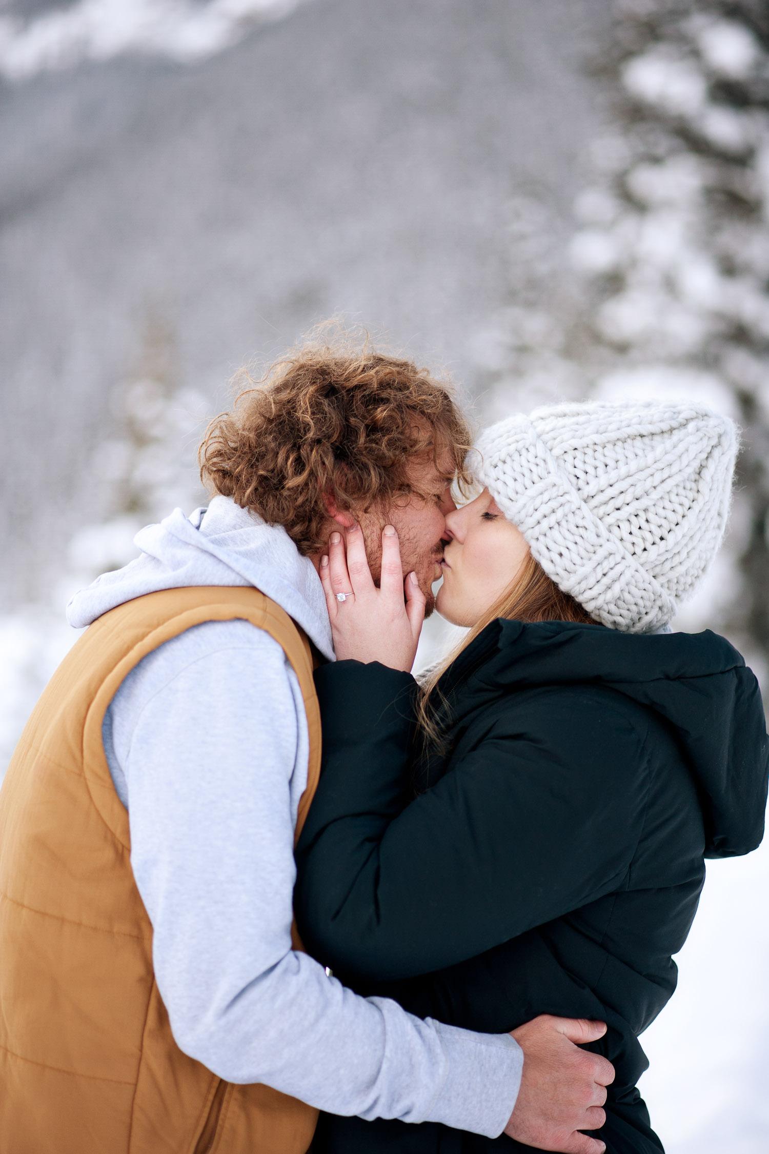 newly engaged at Lake Louise captured by Calgary wedding photographer Tara Whittaker