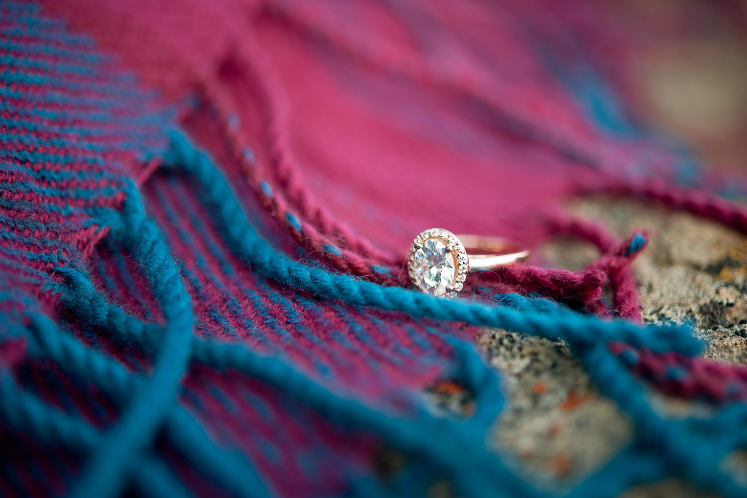 rose gold engagement ring at Minnewanka engagement session captured by Calgary wedding photographer Tara Whittaker