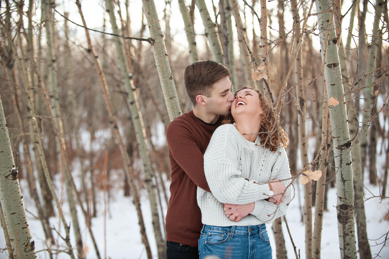 Couple laugh during their Edworthy Park engagement session captured by Tara Whittaker Photography