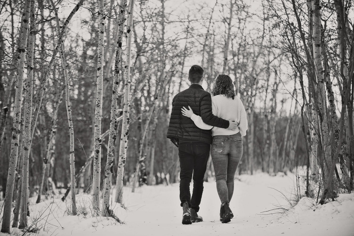 Couple stroll during their Edworthy Park engagement session with Tara Whittaker Photography