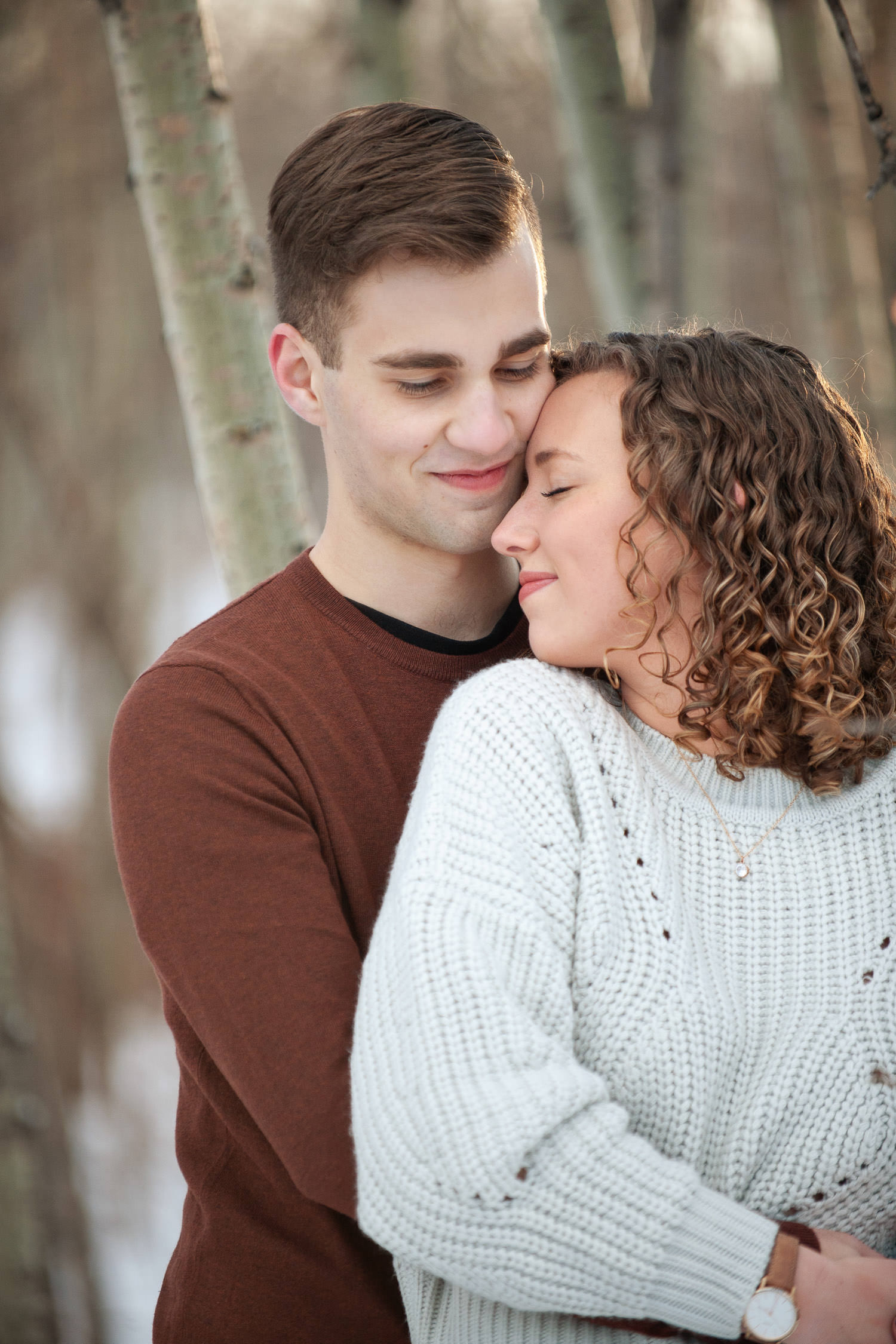 Sweet moment during winter engagement session at Edworthy Park captured by Tara Whittaker Photography