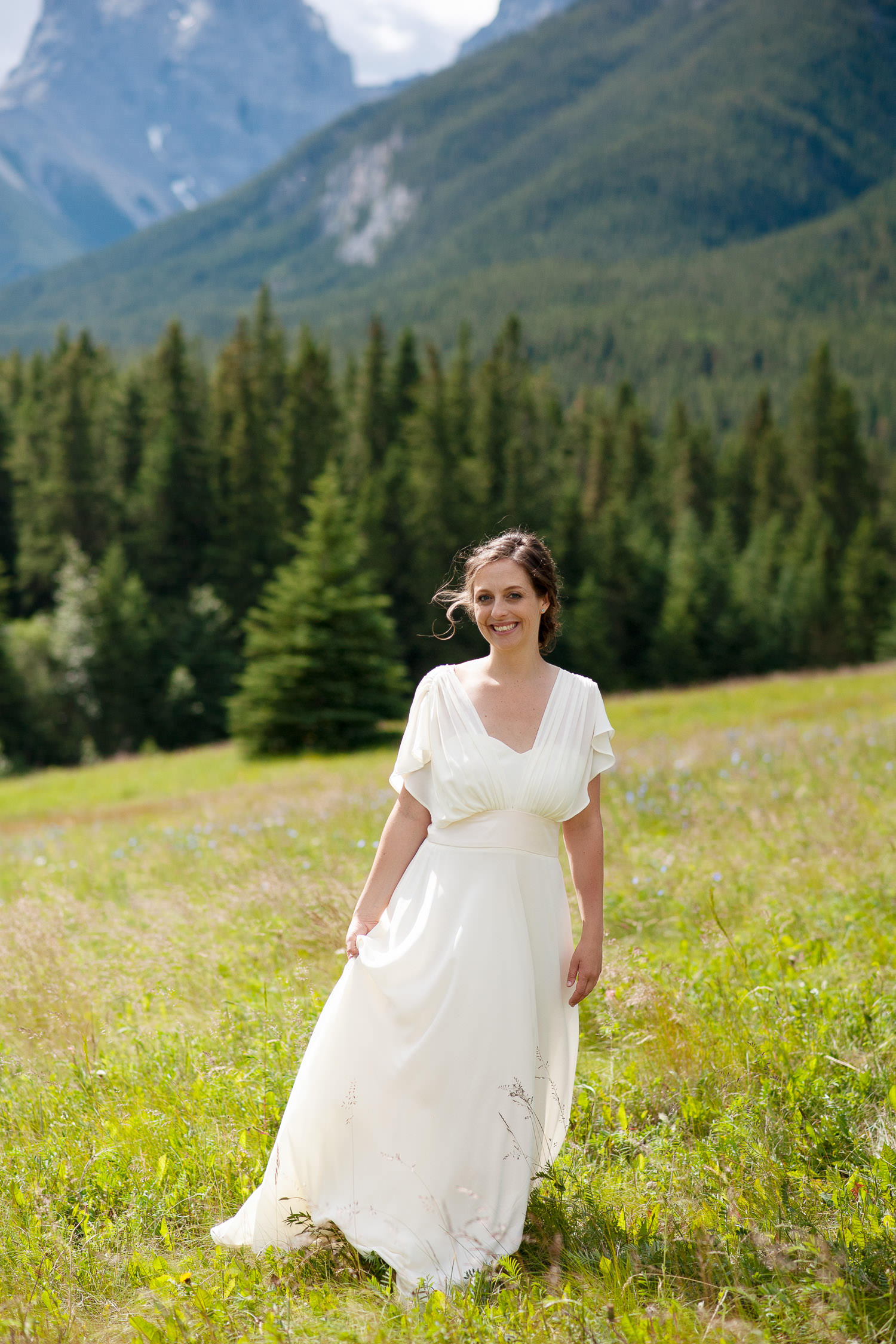 bride after her wedding at Quarry Lake in Canmore captured by Tara Whittaker Photography