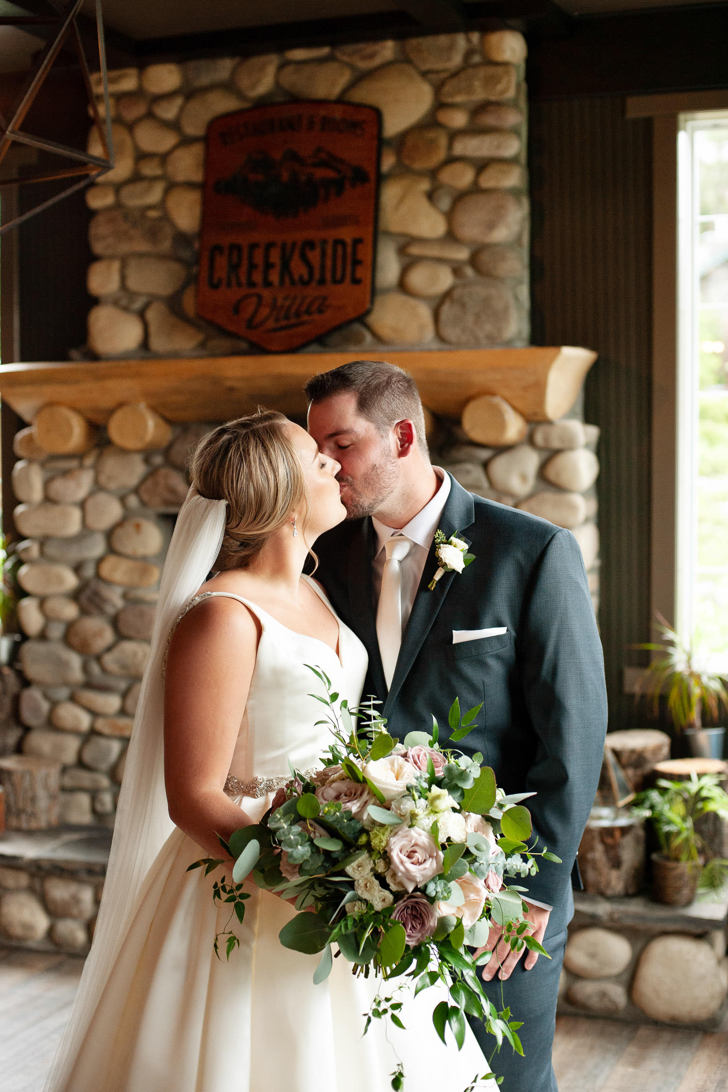 bride and groom kiss at their Creekside Villa wedding captured by Tara Whittaker Photography