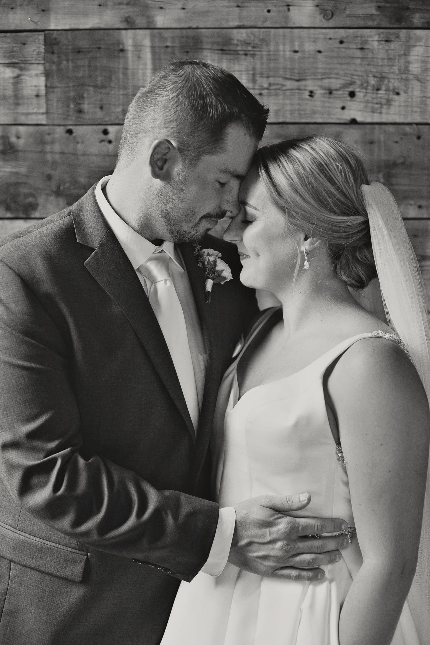 bride and groom embrace at their intimate Canmore wedding captured by Tara Whittaker Photography