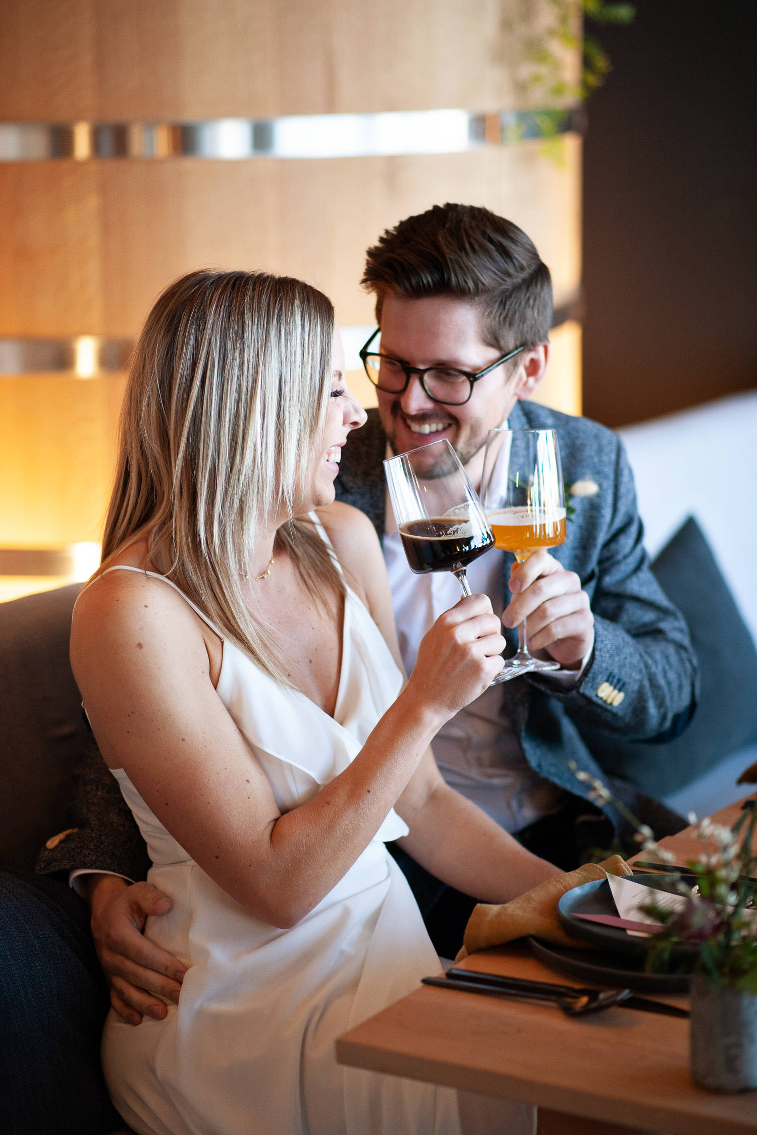 Bride and groom share a toast at their Annex Ale Project wedding captured by Tara Whittaker Photography