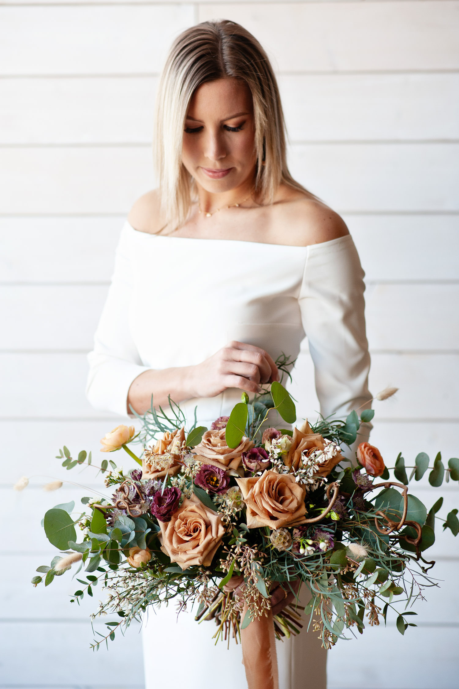 bride with her bouquet from Sweet Blooms captured by Tara Whittaker Photography