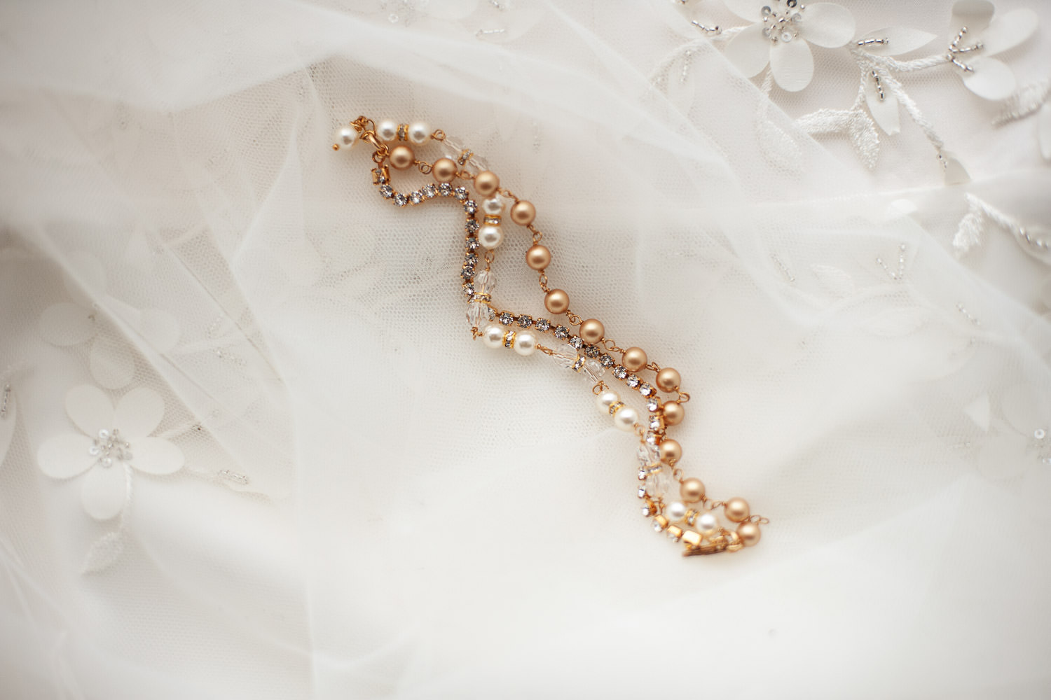 bridal bracelet by Calgary jewelry designer Joanna Bisley captured by Tara Whittaker Photography