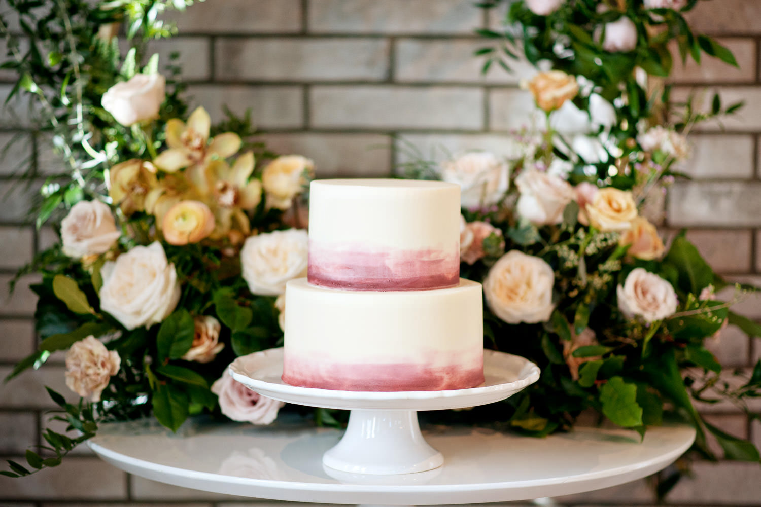 Watercolor wedding cake from Crave captured by Tara Whittaker Photography