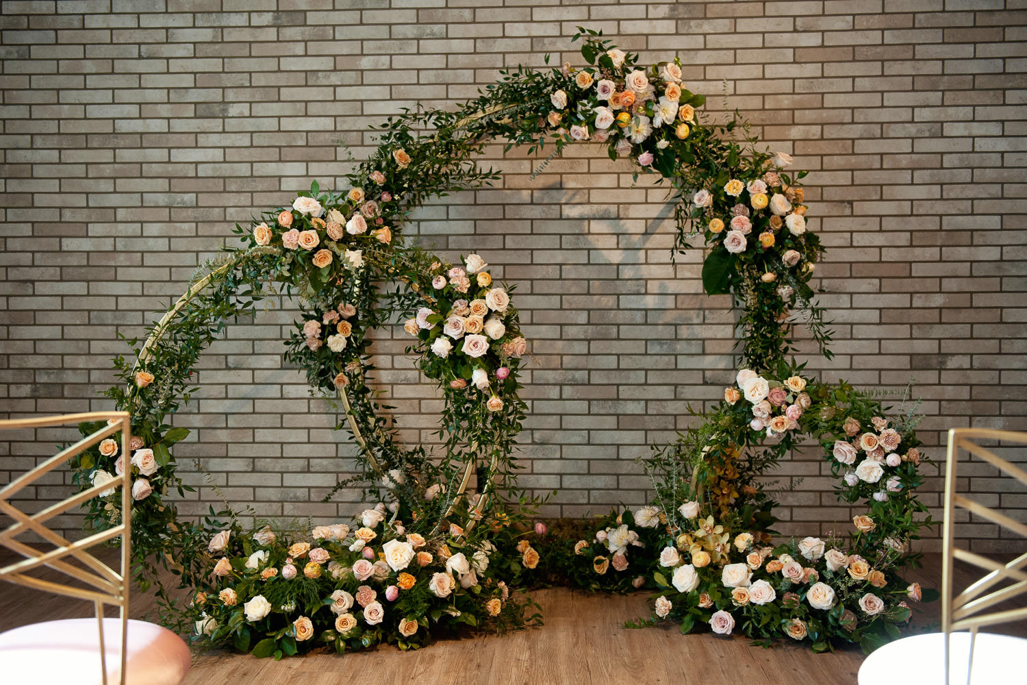Circular ceremony arches from Flowers by Janie captured by Tara Whittaker Photography