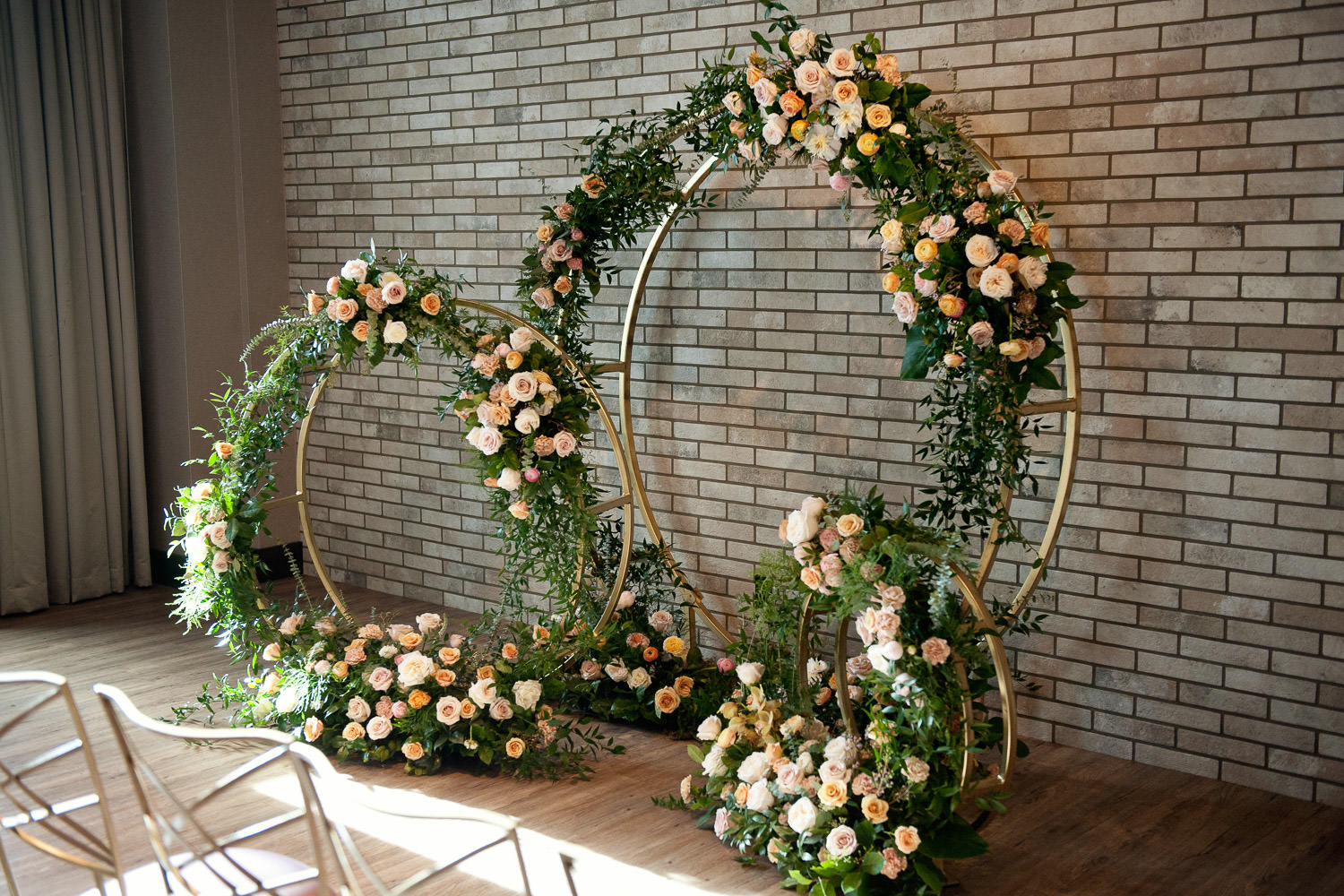three circular ceremony arches by Flowers by Janie captured by Tara Whittaker Photography