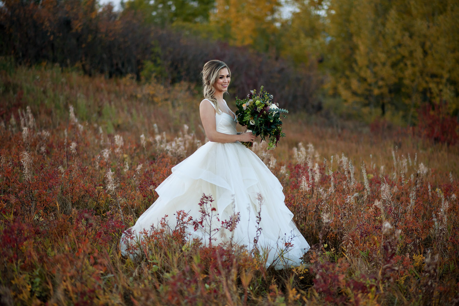 bride in Nose Hill Park captured by Tara Whittaker Photography