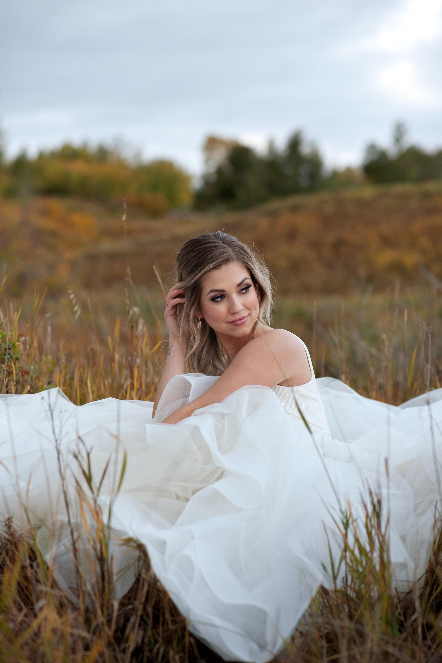 Fall bride in Nose Hill Park captured by Calgary wedding photographer Tara Whittaker