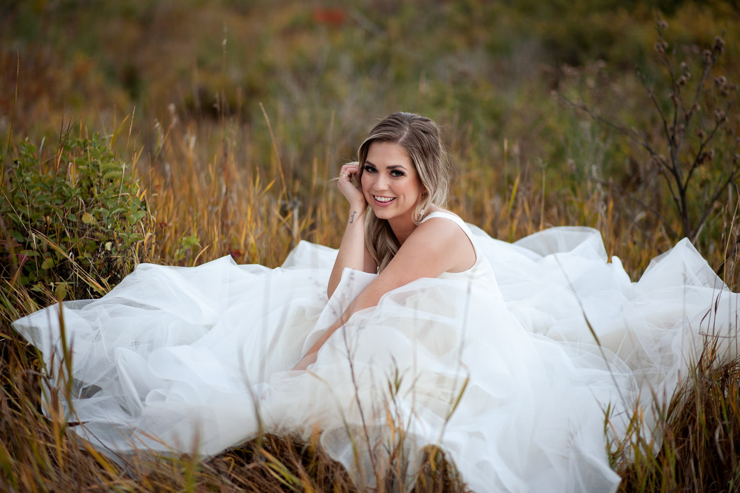 Fall bride wearing Hayley Paige in Nose Hill Park captured by Tara Whittaker Photography