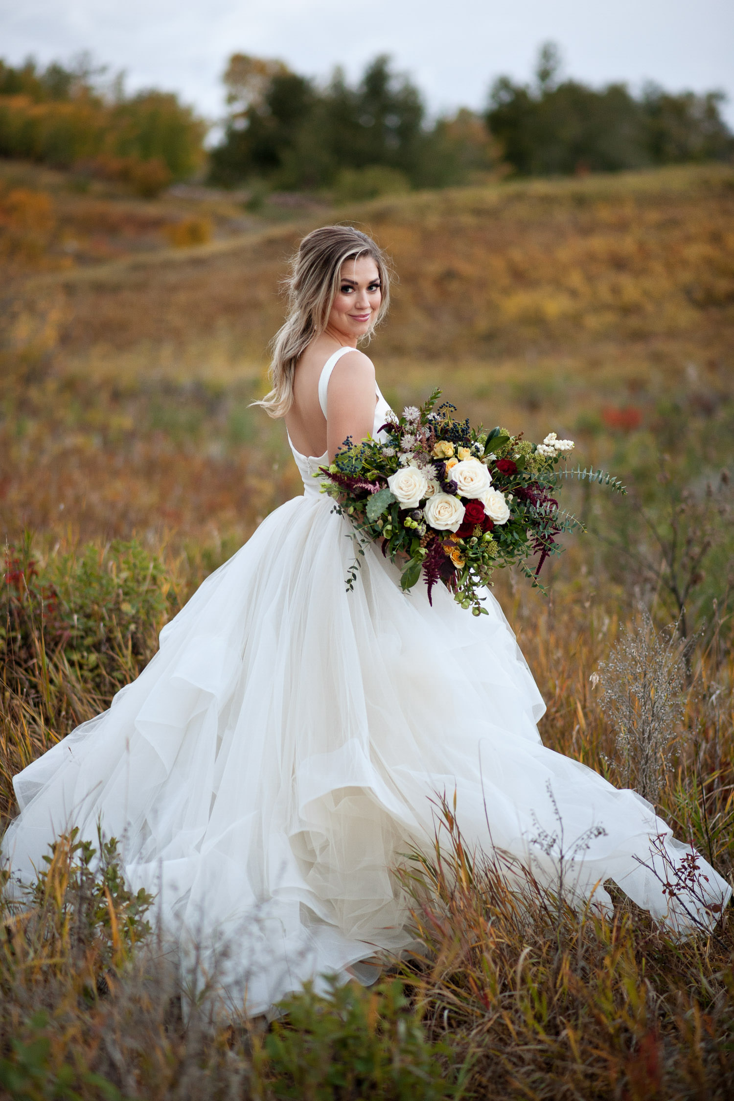 bride in Nose Hill Park wearing Hayley Paige captured by Tara Whittaker Photography