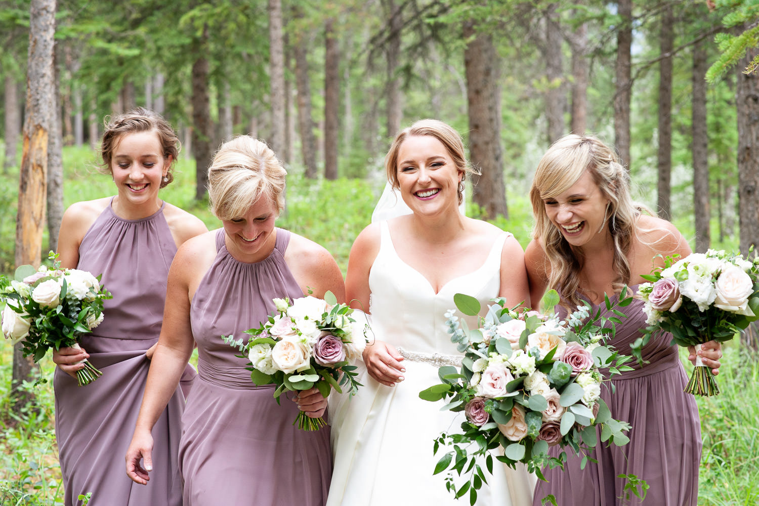 Bride with her bridesmaids after a Creekside Villa wedding captured by Tara Whittaker Photography