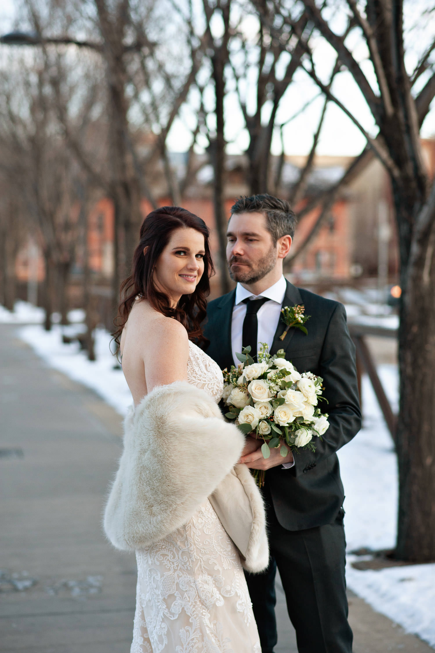 winter bride outside Venue 308 captured by Calgary wedding photographer Tara Whittaker