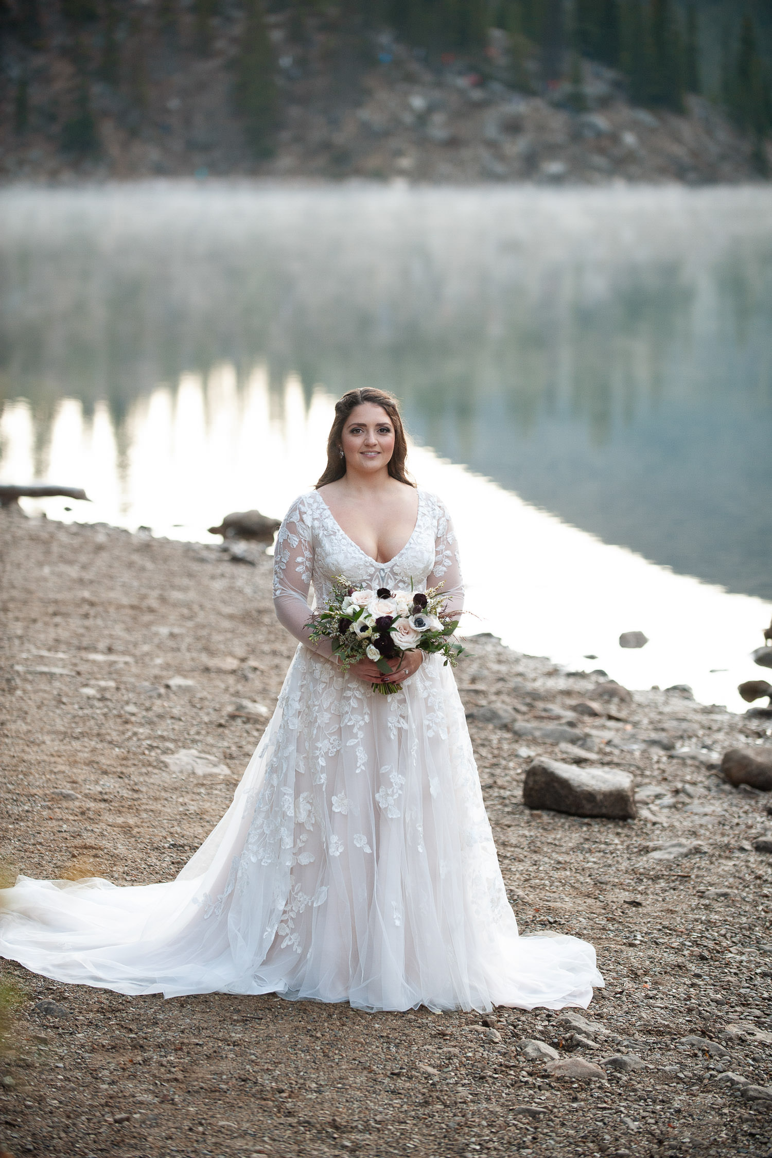 Bride waits for her groom at her Moraine Lake elopement captured by Tara Whittaker Photography
