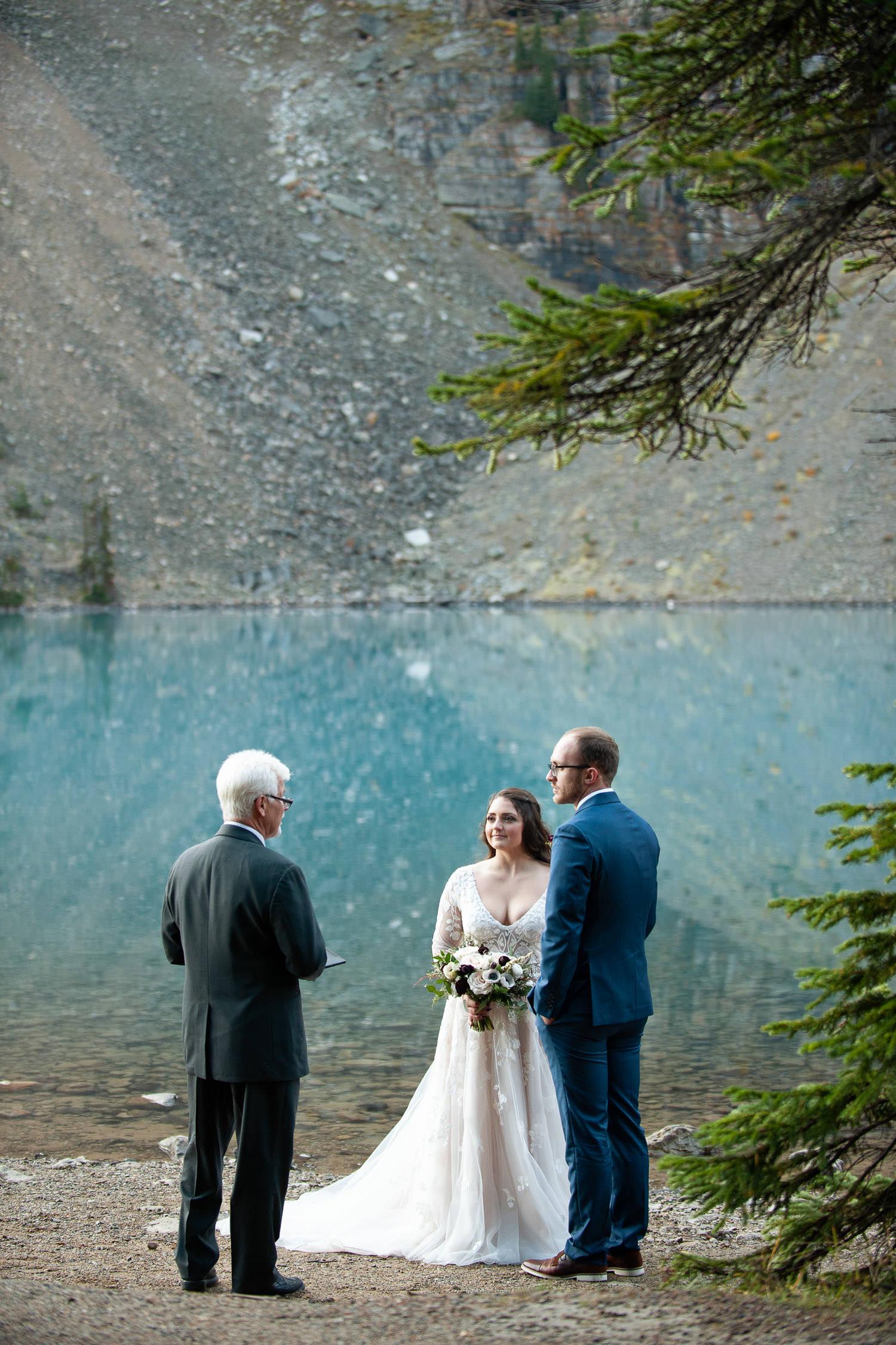 Wedding ceremony at Moraine Lake captured by Tara Whittaker Photography