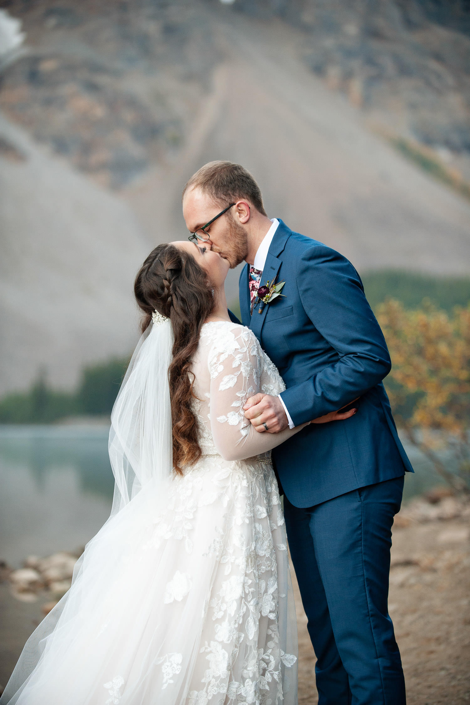First kiss at Moraine Lake elopement captured by Tara Whittaker Photography