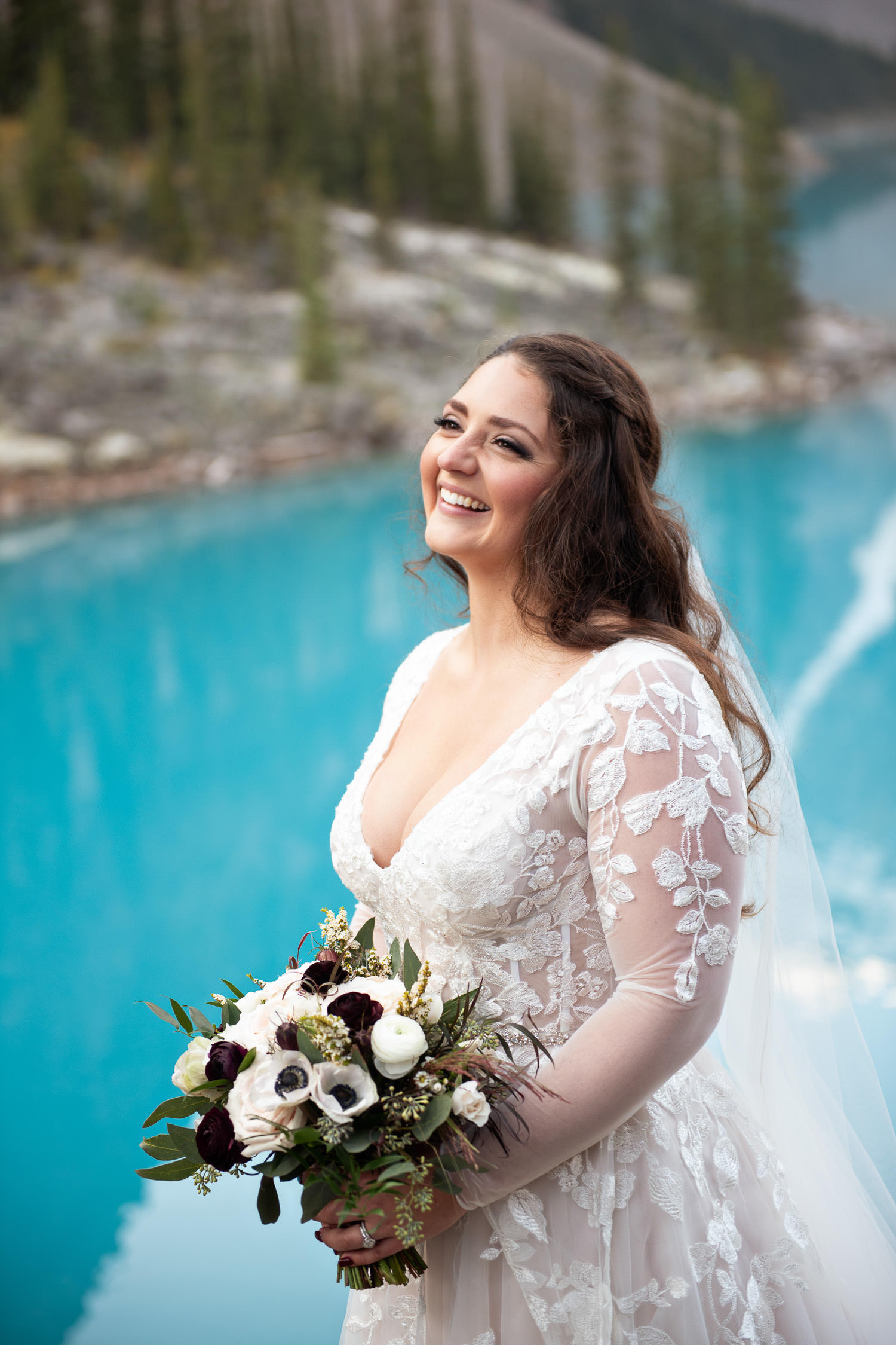 Bride with her bouquet from Flowers by Janie at Moraine Lake